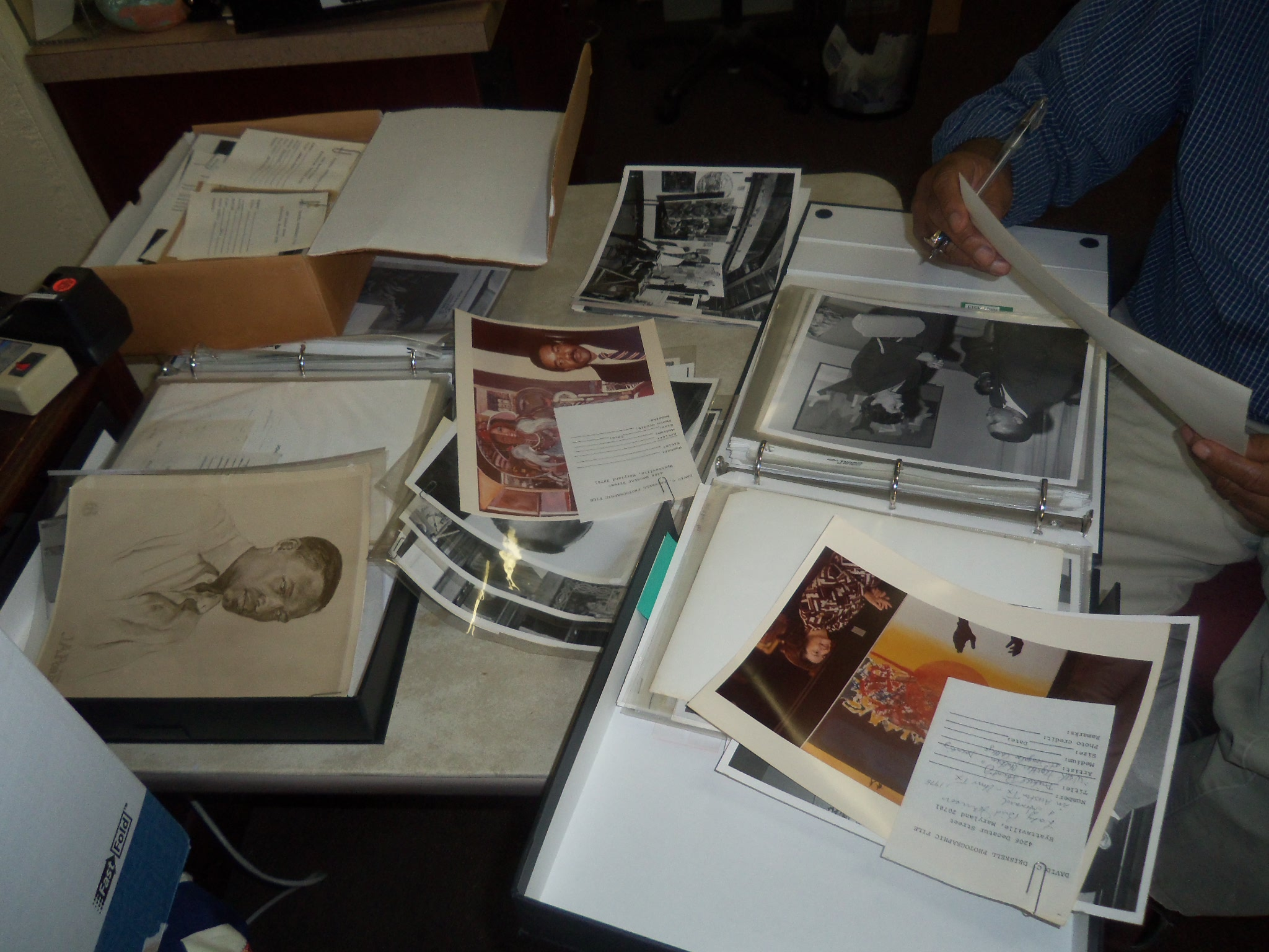 Old photos of Professor Driskel scattered on table